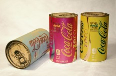 "Coke Zero Cans, each 12.5"" x 7.5"" x 7.5"", mixed media: screenprints on metalized laminate and cardboard, 2011."