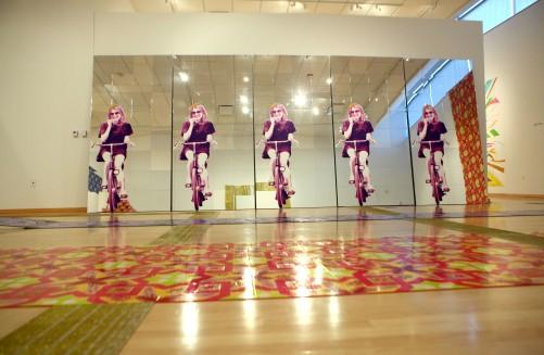 """Yarmulke Girl, 8' x 20' x 2"""", mixed media: screenprints on mirror, foam, and wood, 2011."""