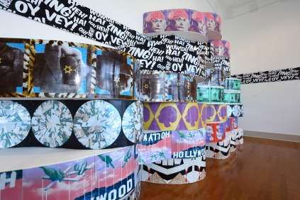 Untitled (Installation from Urban Pop), site specific, dimensions approximately 30' x 20' x 18', mixed media: screenprints on linoleum, wood, paint, and faux leather vinyl, 2013.