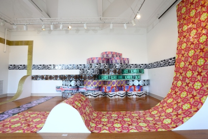 Untitled (Installation from Urban Pop), site specific, dimensions approximately 30' x 20' x 18', mixed media: screenprints on linoleum, glitter, wood, paint, and faux leather vinyl, 2013.