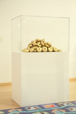 Golden Bagels, 2′ x 3′ x 5′, mixed media: wood, acrylic vitrine, plaster, gold spray paint, and paint, 2011. Glitzianers, MFA thesis show, Temple Contemporary, Philadelphia, PA.