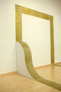 Golden Ramp with Gold Tile, 9' x 9' x 3' with variable dimension extensions, gold glitter screen-printed on linoleum tile with painted wood armature, 2011. Glitzianers, MFA thesis show, Temple Contemporary, Philadelphia, PA.
