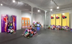 Tasty (installation shot), room dimensions 25' x 34' x 10', mixed media: wood, paint, sceenprints, paper, Tyvek, metalized laminate, mica powder, acrylic paint pours, cardboard, polyester fill, metal brackets, brass chains, and animation on tv screen, 2017. Tastier, Good Children, New Orleans, LA.
