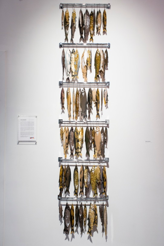 "Smoked Whitefish, 24"" x 108"" x 5"", screenprints on laser cut cast acrylic, metal, 2018."